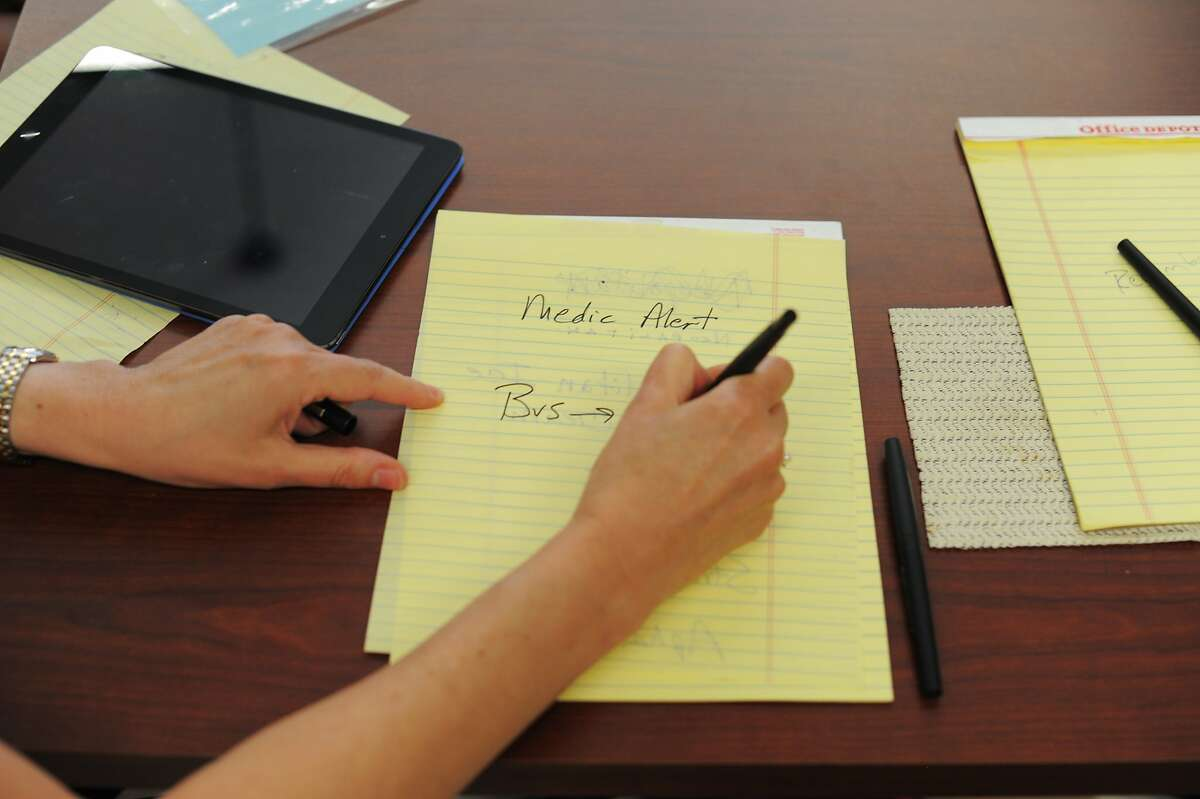 Writing is a tool used to help communicate during a group therapy session at the Aphasia Center of California on August 05, 2014 in Oakland, CA. Aphasia is a condition that usually follows a stroke or other brain injury and impairs a person's ability to communicate. The center helps people with aphasia through group therapy and other classes that encourage social interaction