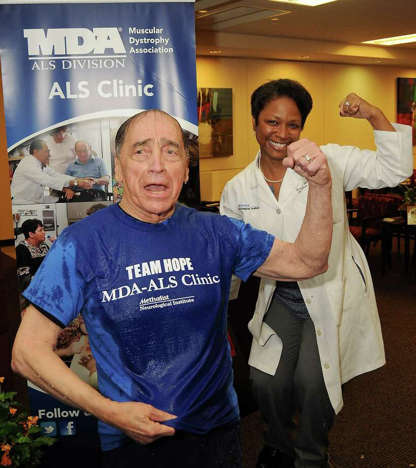 Dr. Stanley Appel and  Dr. Ericka Simpson flex after an Ice Bucket Challenge at the Muscular Dystrophy Association ALS Clinic at the Houston Methodist Neurology Institute Monday Aug. 18.Keep clicking to see other people from Houston and Texas who have taken the challenge. Photo: Dave Rossman, For The Houston Chronicle / © 2014 Dave Rossman