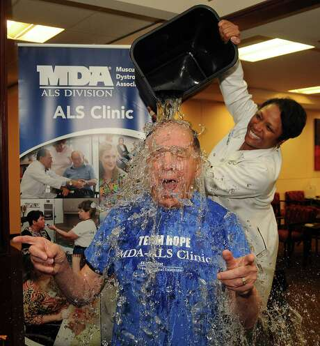 Dr. Stanley Appel has a bucket of ice water dumped on his head by Dr. Ericka Simpson during an Ice Bucket Challenge at the Muscular Dystrophy Association ALS Clinic at the Houston Methodist Neurology Institute Monday Aug. 18, 2014.(Dave Rossman photo) Photo: Dave Rossman, For The Houston Chronicle / © 2014 Dave Rossman