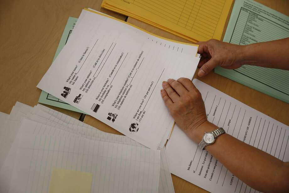 Mission Education Center Elementary School fourth/fifth grade teacher Lilly Chow organizes school folders for incoming students in her classroom as she prepares for the first day of school on Friday, August 15,  2014 in San Francisco, Calif. Photo: Lea Suzuki, The Chronicle
