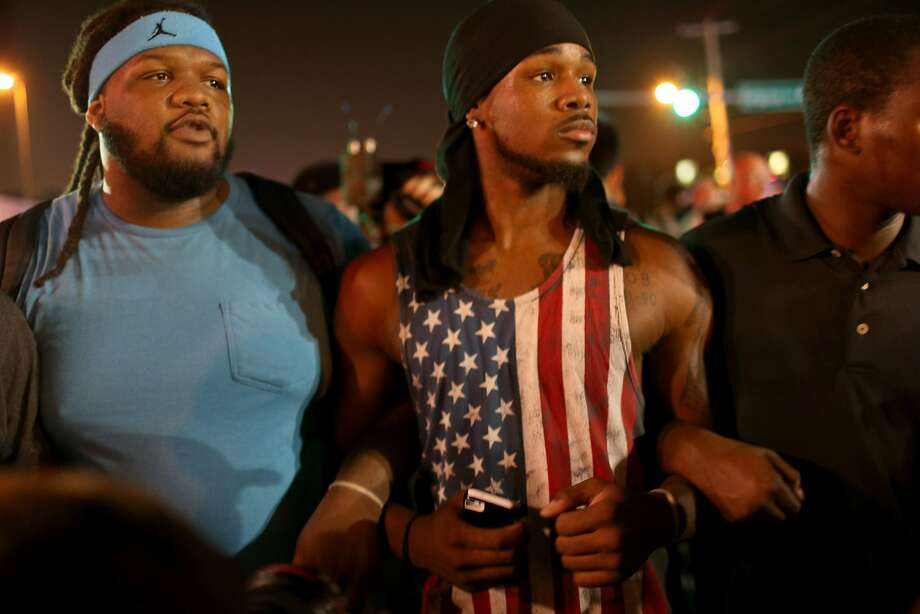 Demonstrators protesting the shooting death of Michael Brown make their voices heard on August 18, 2014 in Ferguson, Missouri. Protesters have been vocal asking for justice in the shooting death of Michael Brown by a Ferguson police officer on August 9th.  Photo: Joe Raedle, Getty Images