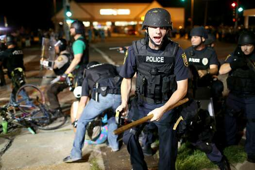 Police officers arrest a demonstrator on August 18, 2014 in Ferguson, Missouri. Violent outbreaks have taken place in Ferguson since the shooting death of unarmed teenager Michael Brown by a Ferguson police officer on August 9th.  Photo: Joe Raedle, Getty Images