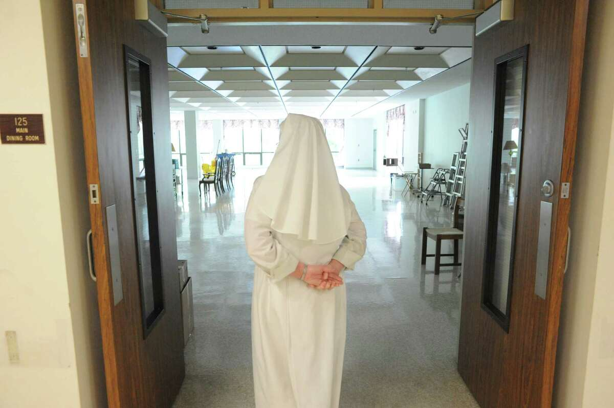 Sister Carol Marie looks at the cleared-out dinning room at The Little Sisters of the Poor on Thursday Aug.14, 2014 in Latham, N.Y. The Little Sisters of the Poor are leaving the Capital Region after 143 years. (Michael P. Farrell/Times Union)