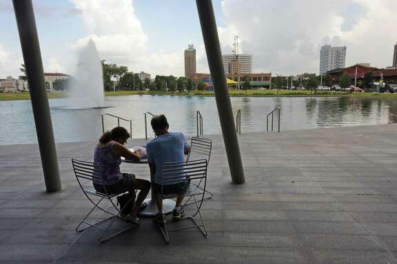 Elizabeth Irving and Frank Irving enjoy a meal during Lunch at the Lake in downtown Beaumont on Monday. The event will continue every Monday from 11:00 to 2:00 until November 24.  Photo taken Monday, August 18, 2014  Guiseppe Barranco/@spotnewsshooter