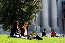 Seniors Janice Lai, left, who is Chinese, and Vivian Nguyen, who is Vietnamese, talk as they sit in the grass in front of Sproul Hall on the Cal Campus in Berkeley, CA, Tuesday, March 11, 2014.   State legislature is considering restoring the ability of California universities to use race and ethnicity in admissions decisions.