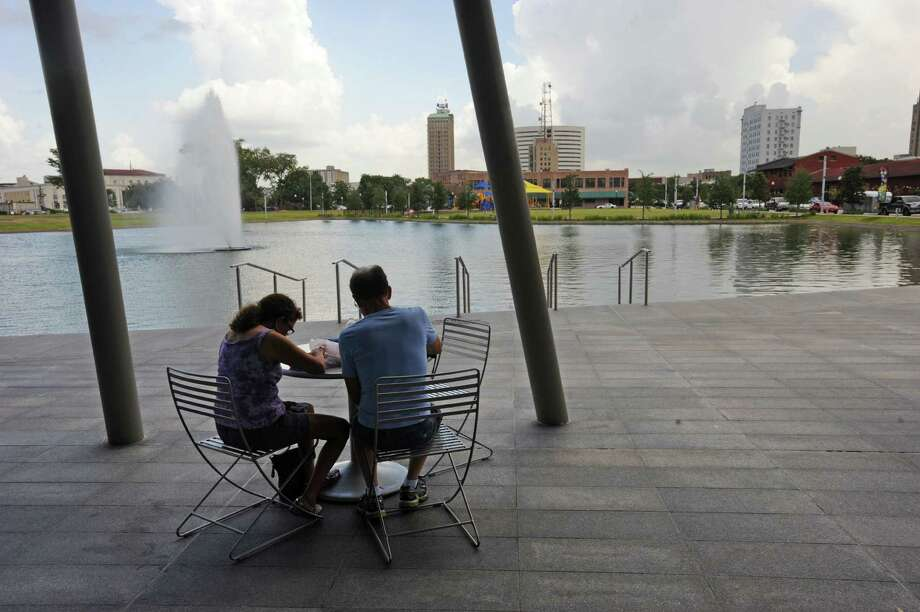 Elizabeth Irving and Frank Irving enjoy a meal during Lunch at the Lake in downtown Beaumont on Monday. The event will continue every Monday from 11:00 to 2:00 until November 24.  Photo taken Monday, August 18, 2014  Guiseppe Barranco/@spotnewsshooter Photo: Guiseppe Barranco, Photo Editor