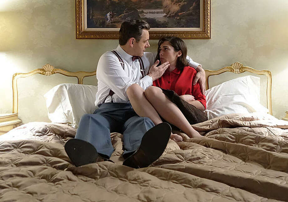 "Michael Sheen and Lizzy Caplan in ""Masters of Sex."""