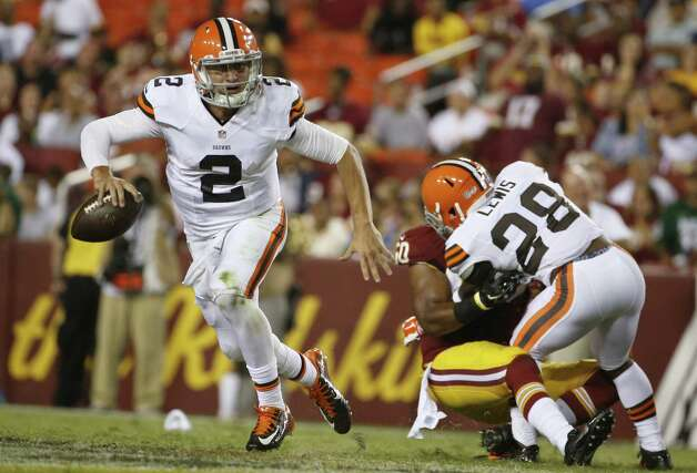 Johnny Manziel was 7 of 16 for 65 yards and a TD, and raised his middle finger to the Redskins' bench. Photo: Evan Vucci / Associated Press / AP