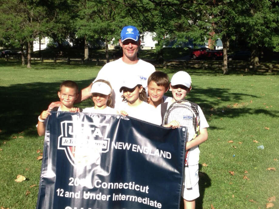 Team Trumbull won the 12-and-under Intermediate Division Championship at a USTA New England event held last weekend in New Haven. From left: Jackson Slattery, Amelia Galin, Alexander Visser, Luke Brodsky and Tighe Brunetti. Coach in the back is Mike Slattery. Photo: Contributed Photo / Westport News Contributed
