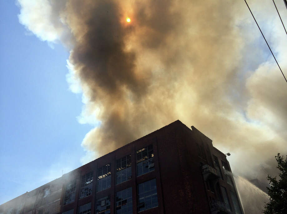 Bridgeport firefighters are battling a series of fires in the vacant Remington factory complex on the cityâÄôs East Side. Photo: Chris Preovolos / Connecticut Post