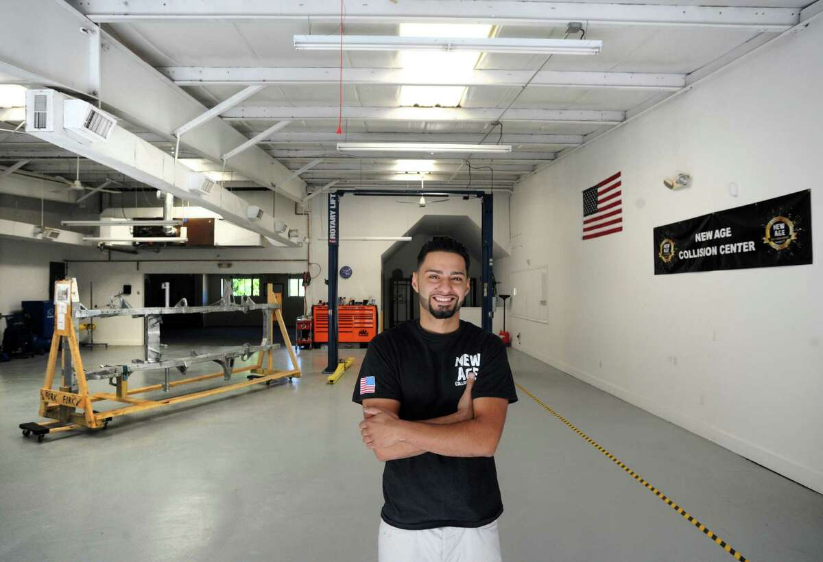 Ramon Soto-Rodriguez at his recently opened a state of the art auto body shop, New Age Collision, on Federal St. in Brookfield, Conn. on Tuesday, Aug. 19, 2014. Soto-Rodriguez is excited about the redevelopment efforts near the Four Corners area of town.