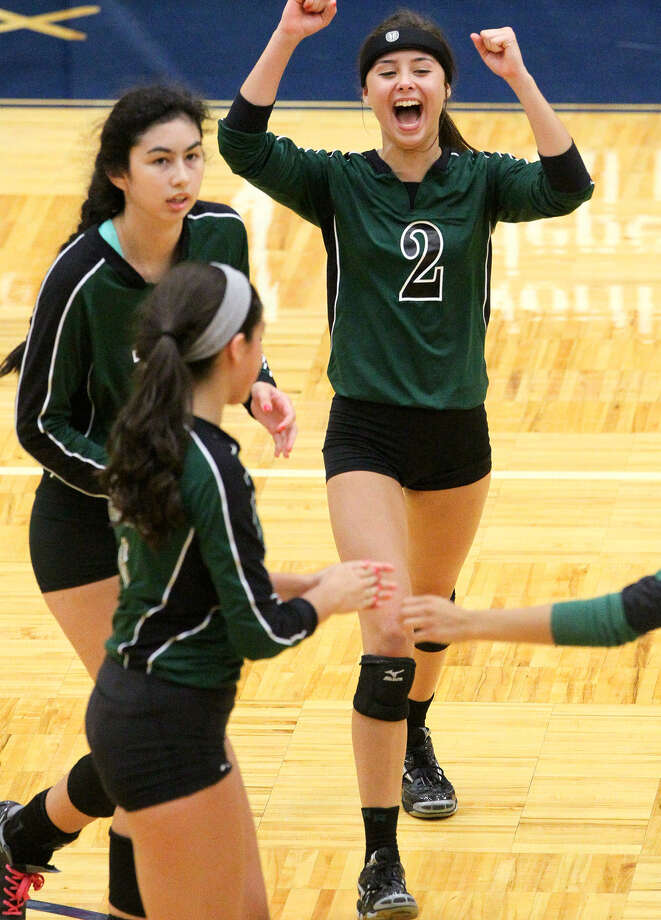 Reagan's Victoria Hinojosa, right, and the Lady Rattlers celebrate a point during their season opening match with Brennan at Paul Taylor Field House on Aug. 11. Reagan beat Brennan in three straight games, 25-16, 25-21, 25-17. Photo: Marvin Pfeiffer / Stone Oak Weekly / EN Communities 2014