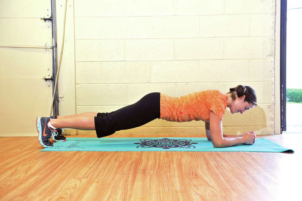 1. START IN A FOREARM PLANK POSITION, head over hands, with your shoulders and neck soft, and hips engaged with your core.