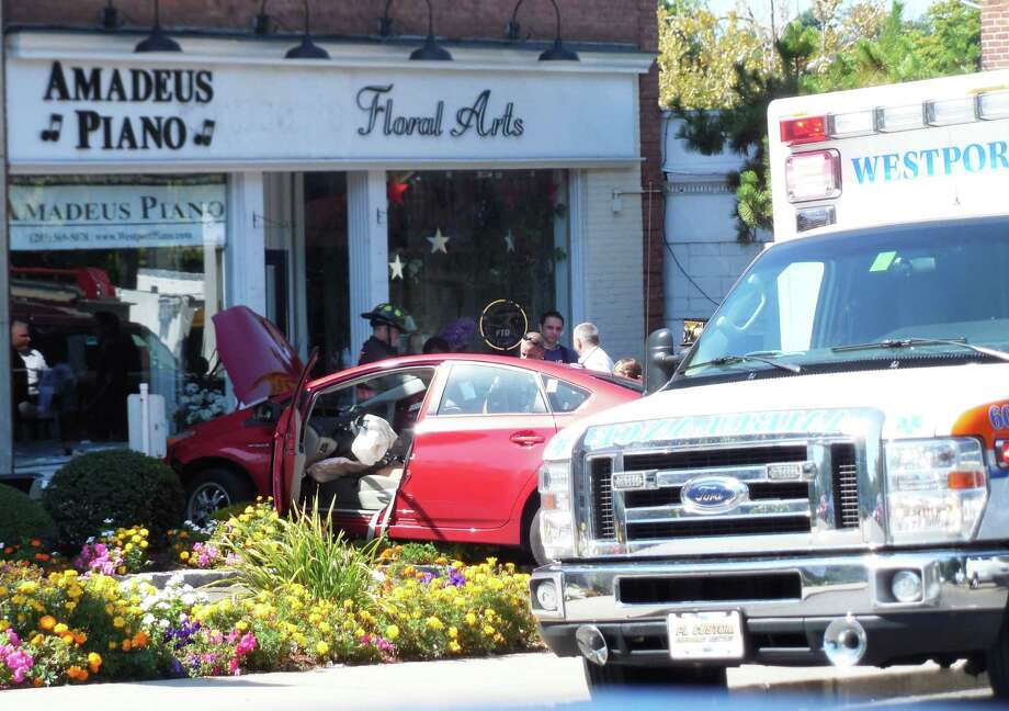 Emergency vehicles responded to Amadeus Piano Co. at 240 Post Road East Tuesday around 10:30 a.m. for a report of an accident. They found a car had hit into the front of the building. The airbag in the car deployed. It wasn't immediately known if the driver was injured. Photo: Anne M. Amato / westport news