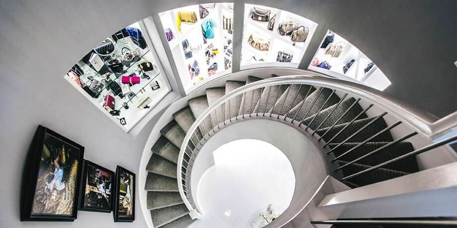 "The three story 3,000 square foot closet recently appeared in news articles all around the world described as a ""female man cave.""Take a look at the three-story closet as it was before and keep clicking for other swanky closets up for sale in Houston. Photo: Chinh Phan/Neiman Marcus"
