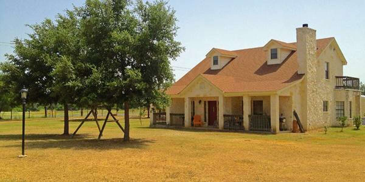 16380 BENTON CITY RD Von Ormy, TX 78073 3 beds, 2 baths - 2,001 sq. ft. $239,500 Built: 1996 MLS ID 1066801 Beautiful Hill Country style, 2-story rock home on 1.79 acres with high ceilings and wood beams, rock fireplace, island kitchen with bay window, and a balcony loft office overlooking living area. First floor master suite with secondary bedrooms upstairs. Spacious covered front porch runs the length of the house while an upstairs balcony is accessed from the the second bedroom. Fenced / cross-fenced property includes a two-car carport with storage space as well as a barn with horse stalls and room for hay storage.
