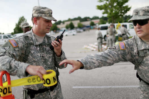 Missouri National Guard troops are deployed to provide protection for a police command center on August 19, 2014 in Ferguson, Missouri. Violent outbreaks have taken place in Ferguson since the shooting death of unarmed teenager Michael Brown by a Ferguson police officer on August 9. Photo: Joe Raedle, Getty Images / 2014 Getty Images