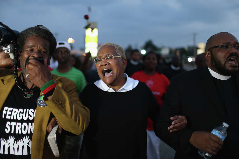 Demonstrators protesting the shooting death of Michael Brown make their voices heard on August 18, 2014 in Ferguson, Missouri. Protesters have been vocal asking for justice in the shooting death of Michael Brown by a Ferguson police officer on August 9th. Photo: Joe Raedle, Getty Images / 2014 Getty Images