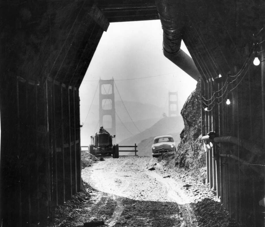 Feb. 28, 1954: Crews dynamit through the second bore of the Waldo Tunnel, showing the Golden Gate Bridge in the distance on the other side. Photo: Art Frisch, The Chronicle