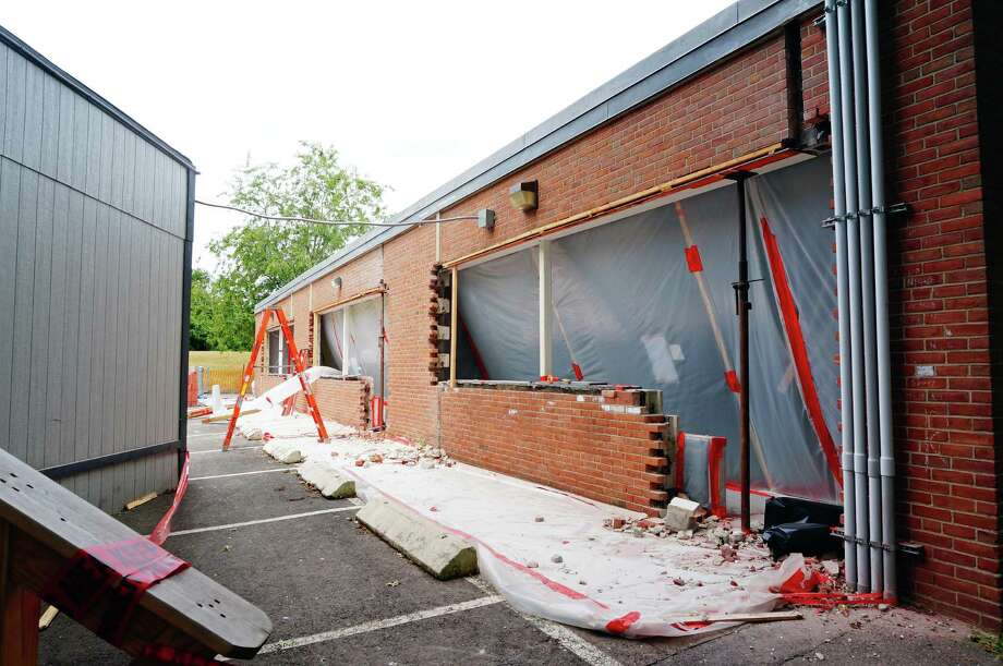The project to replace windows at Osborn Hill School continued over the summer, with more work planned for next year. Photo: Genevieve Reilly / Fairfield Citizen