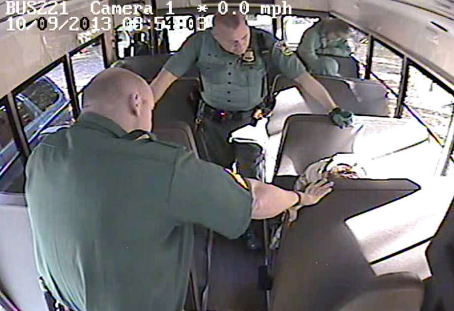 Screen grab from surveillance video which shows Rotterdam Police officers forcefully removing Jacob Gocheski, 16, from a Mohonasen Transportation school bus after Gocheski threatened the bus driver. The Gocheski's arm was broken during the brief skirmish. (Courtesy Rotterdam Police)