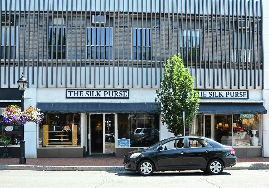 Silk Purse, a 41-year-old consignment shop located at 118 Main St., New Canaan, Conn., is shutting its doors Sept. 30, 2014. Owner Keren Widmann said the decline in sales was one of the major factors that led to the decision. Photo: Nelson Oliveira / New Canaan News