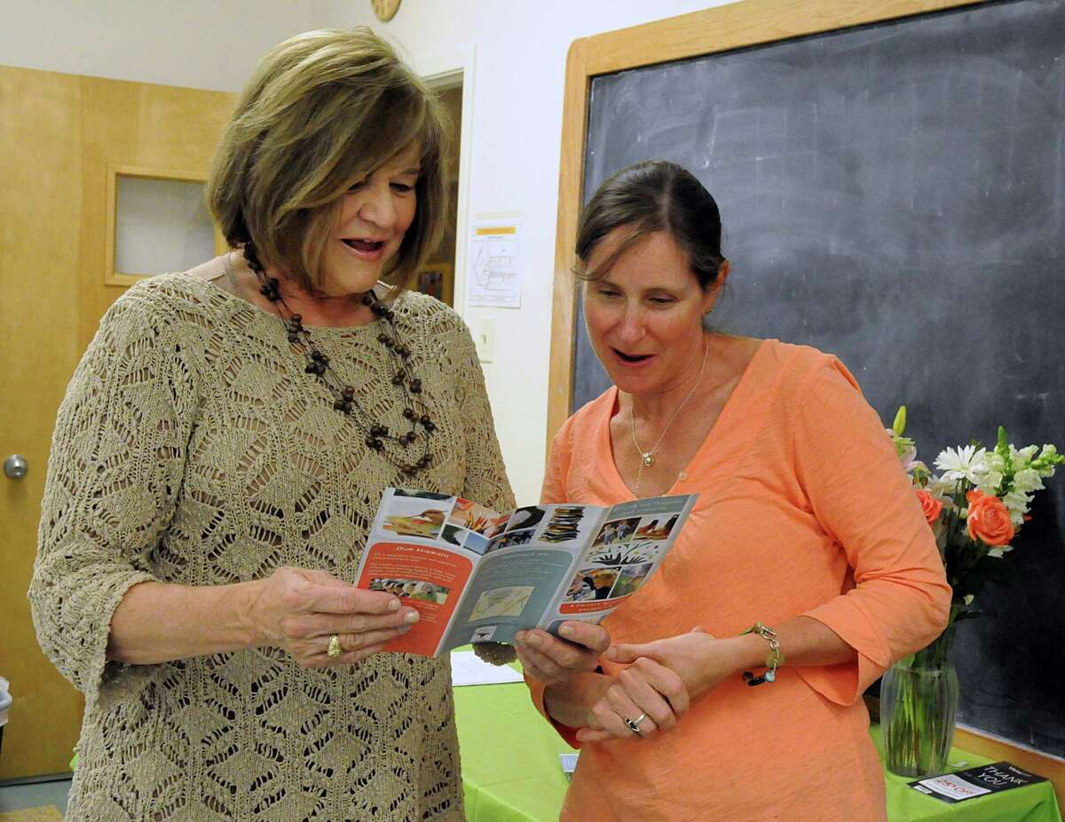 School President Dr. Linda Ellis talks about the school curriculum to prospective parent Marci Murphy, of The Woodlands, during the open house of the new Center for Teaching and Learning of The Woodlands, a new private school set to open, this fall, at Congregation Beth Shalom, 5125 Shadowbend Place in The Woodlands. Photo by David Hopper