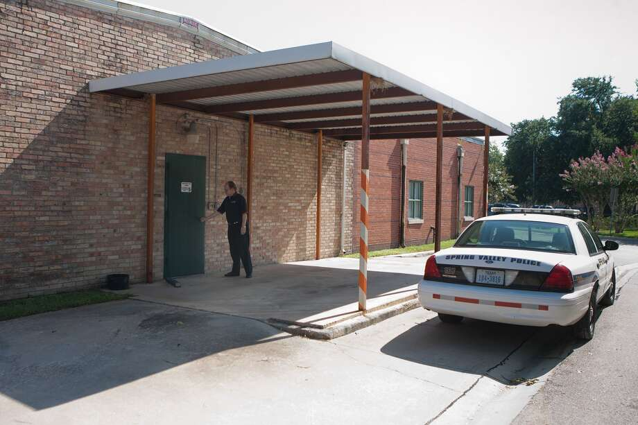 Spring Valley Village Police Chief Gary Finkelman shows one of the major security problems with the existing police station. This door, which is used to transfer prisoners to and from patrol cars and transport vehicles, opens into an insecure carport instead of a proper sally port, a closed garage with independent locks on the doors. As a result, Finkelman said, prisoners are sometimes inclined to try to run. Should the November bond election pass, the new police station will have a full sally port.  Spring Valley Village Police Chief Gary Finkelman shows one of the major security problems with the existing police station. This door, which is used to transfer prisoners to and from patrol cars and transport vehicles, opens into an insecure carport instead of a proper sally port, a closed garage with independent locks on the doors. As a result, Finkelman said, prisoners are sometimes inclined to try to run. Should the November bond election pass, the new police station will have a full sally port. Photo: R. Clayton McKee, Freelance / © R. Clayton McKee