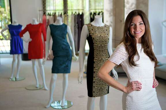 Andrea Phillips, stands next to some of her designs at Tootsies. Phillips is originally from Houston, but currently resides in London. The entrepreneur is launching her first fashion collection for fall 2014 and spring 2015. Friday, Aug. 15, 2014, in Houston. ( Marie D. De Jesus / Houston Chronicle )