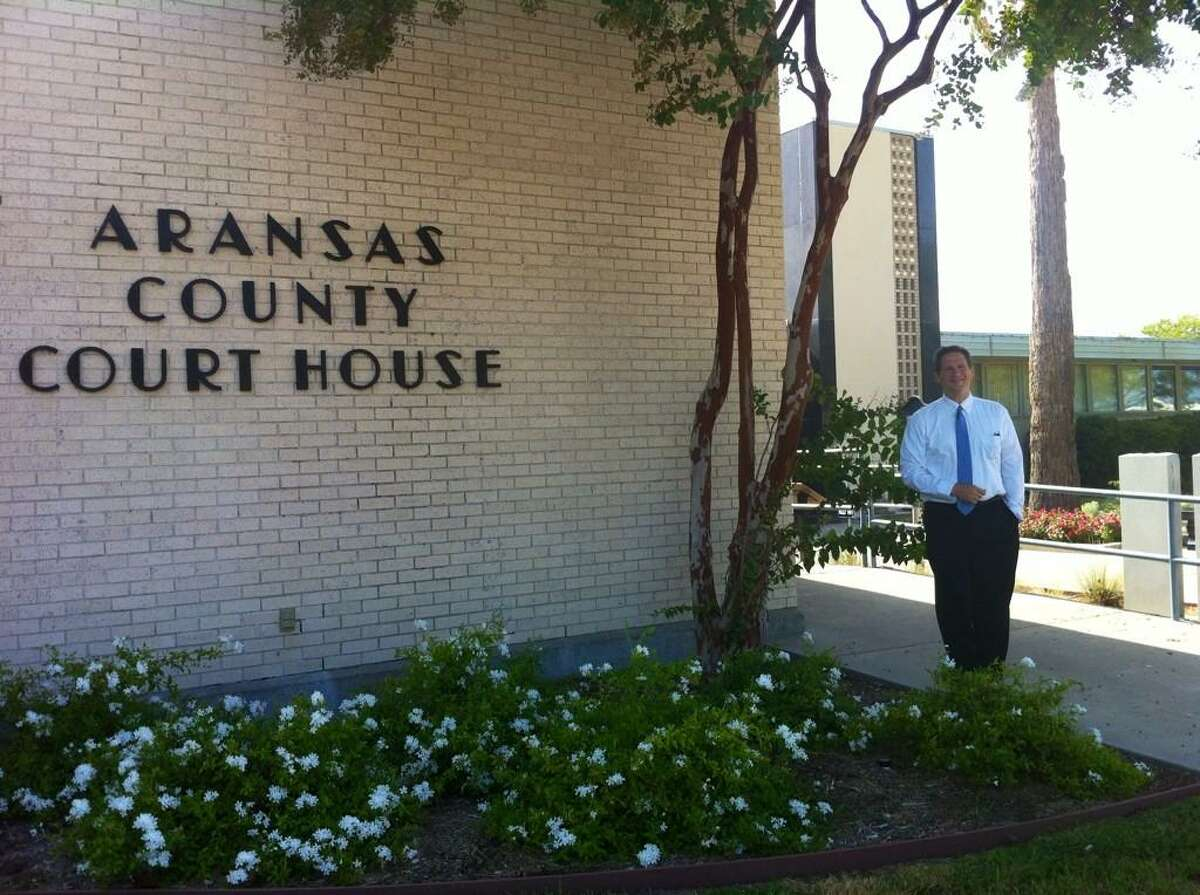 """Justice Jeff Boyd at Aransas County Courthouse, No. 127 on the list and the mid-way point in his project. Boyd writes on Facebook, """"Aransas, the second smallest Texas county, is named for an early nearby Spanish outpost, Rio Nuestra Señora de Aranzazu."""""""