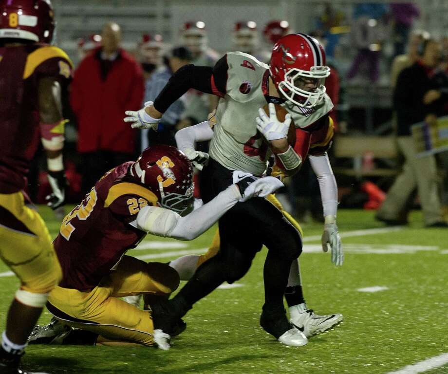 New Canaan's Frank Cognetta carries the ball during the FCIAC championship game at Trumbull High School on November 22, 2013. Cognetta will miss the beginning of 2014 with a broken foot. Photo: Lindsay Perry / Stamford Advocate