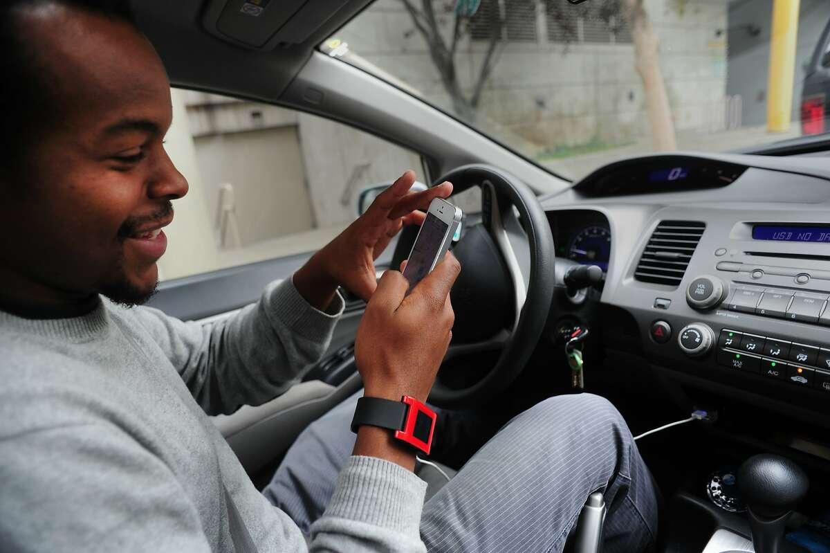 Lyft driver Jibril Jaha demonstrates how his communications application