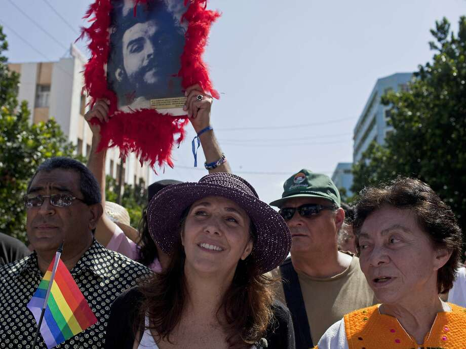 FILE - In this May 10, 2014, file photo, Mariela Castro, daughter of Cuba's President Raul Castro, center, marches in a parade marking the upcoming International Day Against Homophobia, in Havana, Cuba. Castro, the daughter of President Raul Castro and niece of Fidel Castro, broke with tradition and voted ?no? in parliament to a workers' rights bill that she felt didn't go far enough to prevent discrimination against people with HIV or with unconventional gender identities. It is the first time anybody has ever voted against proposed policy in parliament. (AP Photo/Franklin Reyes, File) Photo: Franklin Reyes, Associated Press