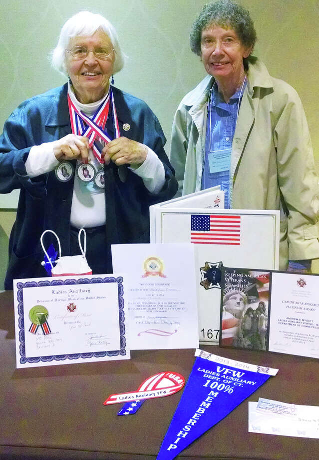 The Ladies Auxiliary of the VFW Post 1672 in New Milford recently took home 10 honors at the state Veterans of Foreign Wars convention in East Hartford. Above, Bette-Lou Emmons, left, president of the local VFW auxiliary, joins Ann Lowell, 17-year treasurer, alongside the organization's accolades.  Courtesy of VFW Ladies Auxiliary Photo: Contributed Photo / The News-Times Contributed
