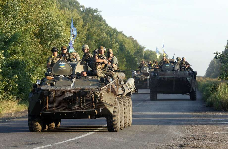 A column of Ukrainian soldiers heads down a road near the small Ukrainian city of Druzhkivka, in eastern Ukraine's disputed Donetsk region. Photo: Anatolii Stepanov, AFP/Getty Images