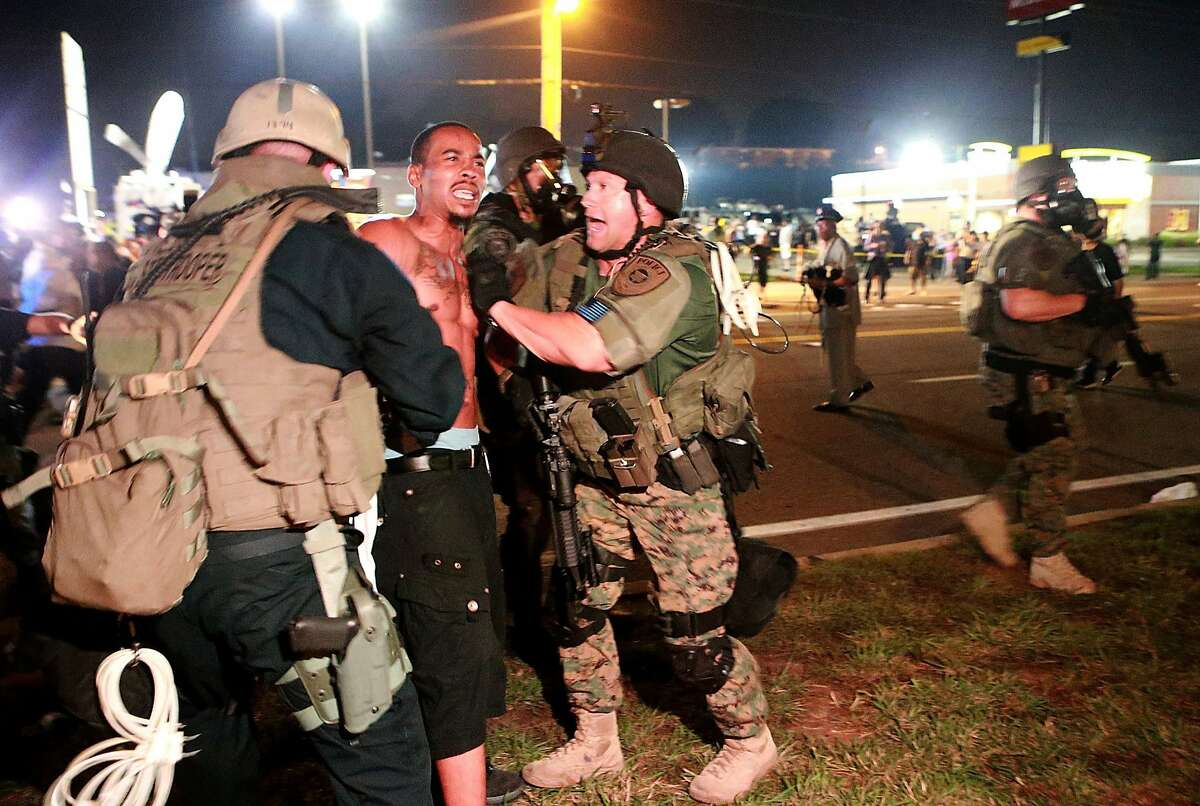 A protestor is arrested on W. Florissant Avenue during a clash with police on Monday, August 18, 2014 in Ferguson, Mo. (Christian Gooden/St. Louis Post-Dispatch/MCT)