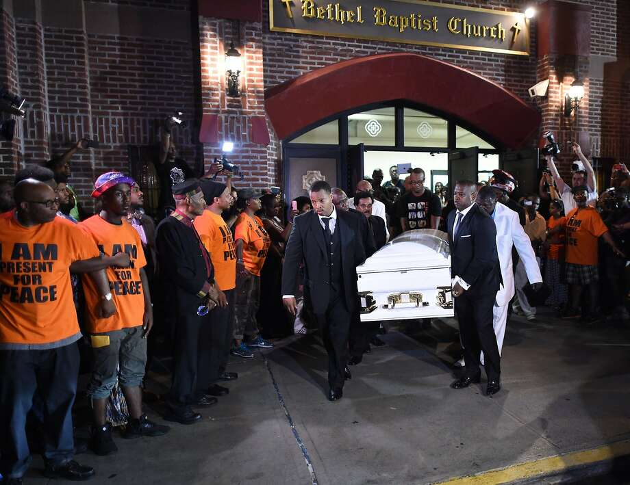 (FILES) This July 23, 2014 file photo shows pallbearers as they carry out the casket of Eric Garner after the funeral service at the Bethel Baptist Church in Brooklyn.  A New York prosecutor announced August 19, 2014 he will convene a grand jury to probe the death last month of a 43-year-old black man placed in a chokehold by police. Eric Garner, a father of six who was suspected of illegally selling cigarettes, was wrestled to the ground by several white police officers after resisting arrest in Staten Island July 17. An amateur video showed police subduing him with a chokehold. Garner lost consciousness and was pronounced dead of a heart attack after being transferred to a hospital. AFP PHOTO / Timothy A. CLARYTIMOTHY A. CLARY/AFP/Getty Images Photo: Timothy A. Clary, AFP/Getty Images