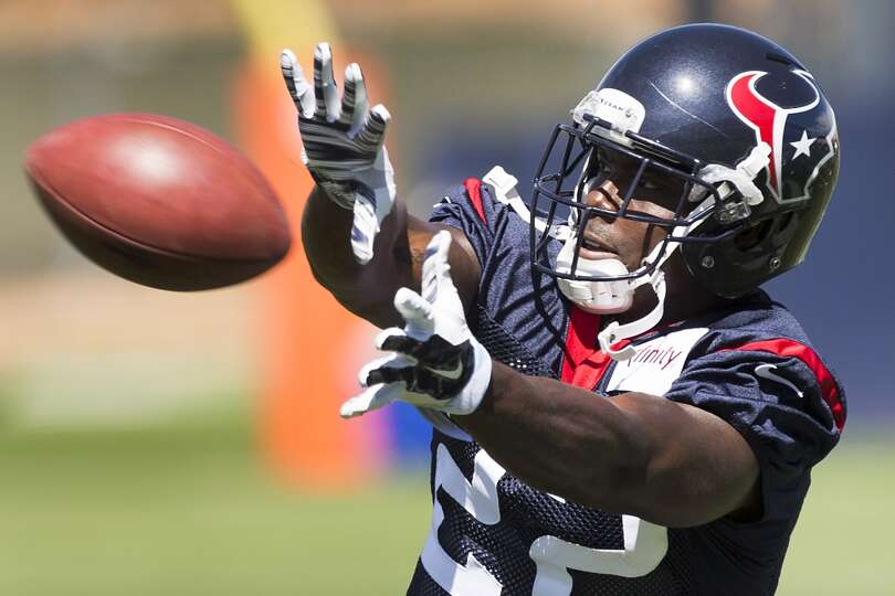 Texans running back Ronnie Brown reaches out to make a catch.
