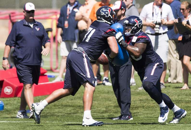 Texans tackles Duane Brown (76) and Anthony Dima (71) run a blocking drill.