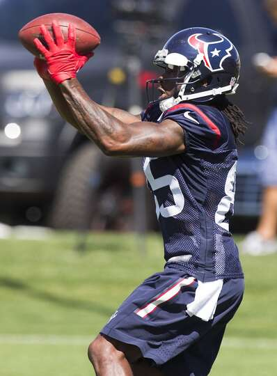 Texans wide receiver Joe Adams reaches out to make a catch.