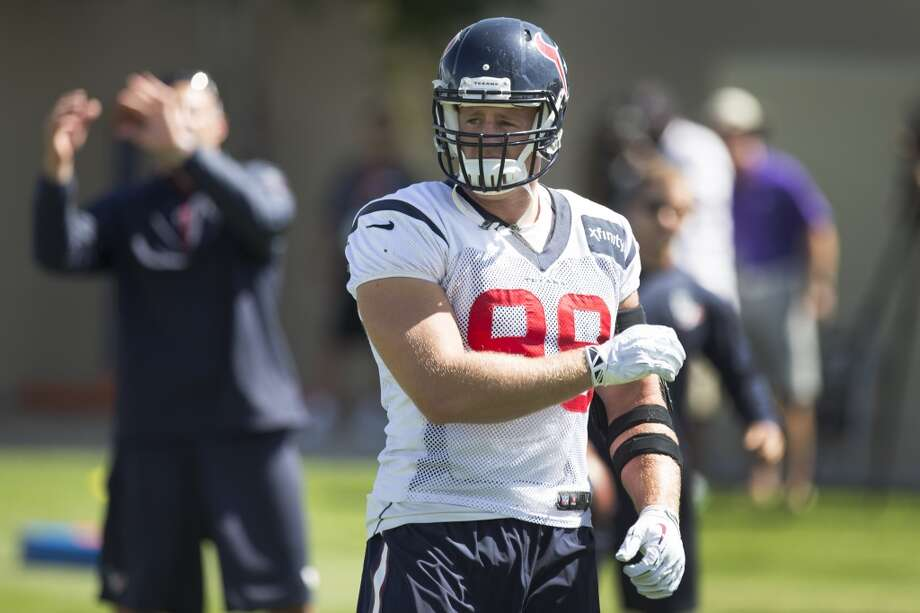 Texans defensive end J.J. Watt runs a drill. Photo: Brett Coomer, Houston Chronicle