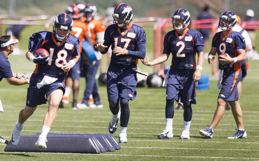 Broncos quarterbacks Peyton Manning (18), Brock Osweiler (17), Zac Dysert (2) and Bryn Renner (9) ru
