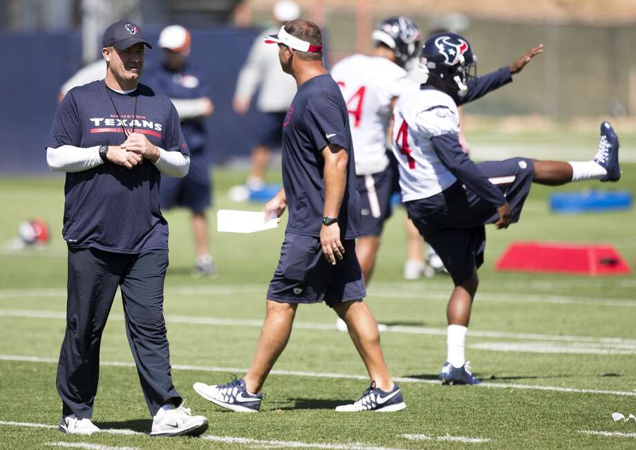 Texans head coach Bill O'Brien walks across the practice field. Photo: Brett Coomer, Houston Chronicle