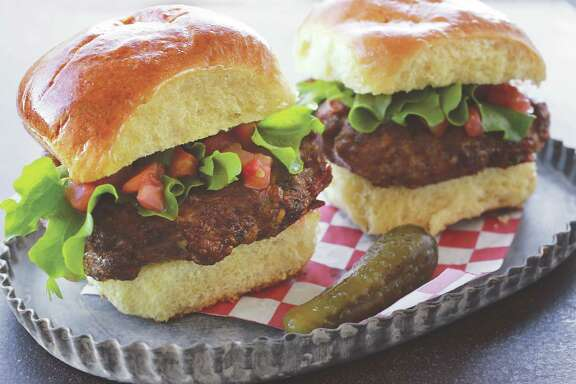 "Instead of dry soup mix, Cheryl Najafi uses dried herbs, salsa and cheddar in Meatloaf Sliders, featured in ""Mother Daughter Dishes."""