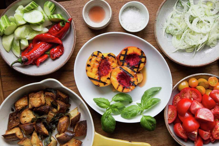 Melissa Perello, chef at Frances restaurant, uses a variety of ingredients for a panzanella salad including toasted levain bread, grilled stone fruit, fennel, tomatoes, peppers and cucumbers at her home in San Francisco, Calif., Thursday, July 31, 2014 Photo: Jason Henry, Contributor / ONLINE_YES