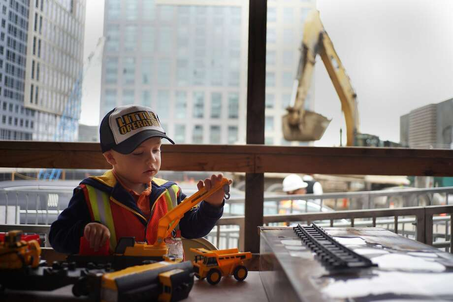 Renzo Lombardi plays with his set of construction toys after touring the construction site at 33 8th St. on Aug. 19. Renzo has kidney cancer. Photo: James Tensuan, The Chronicle