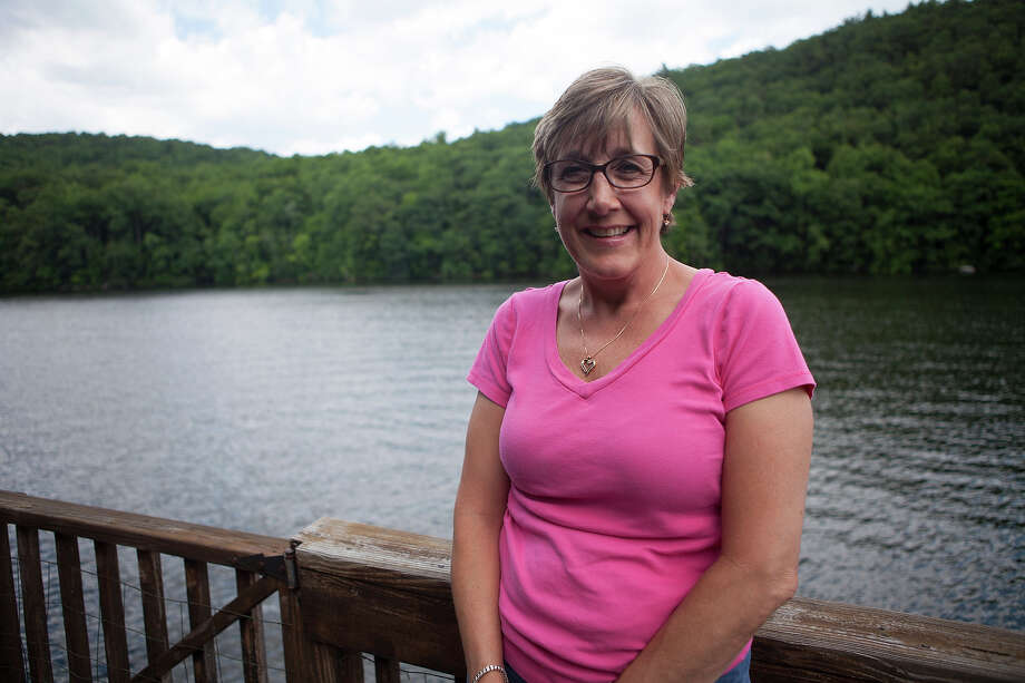 "Mary Ann Jacob, a Sandy Hook Elementary School library aide and Newtown Board of Education member, poses for a portrait at her home in Newtown, Conn., on June 27, 2014. Jacob helped save children during the 2012 shooting that killed 26.""I think we're at a tipping point. There's enough people getting involved. There's enough people saying ""enough is enough,"" that things are going to change,"" she said. Photo: MORGAN SPIEHS, Morgan Spiehs/News21 / news21.comConnecticut Post contributed"