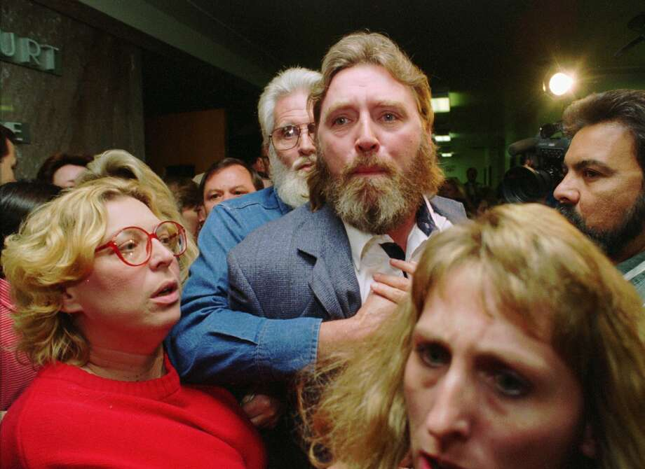 FILE — Randy Ertman is restrained Tuesday, Oct. 11, 1994, in Houston outside the courtroom where he addressed three of the five gang members convicted of killing his daughter and her friend. All five gang members were sentenced to death for the July 1993 slayings of his 14-year-old daughter, Jennifer, and Elizabeth Pena, 16. Photo: DAVID J. PHILLIP, Associated Press / AP