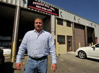 Dave Massi, owner of Fences Etc. Inc, poses for a photograph in front of his business in Stamford, Conn., on Tuesday, Aug. 19, 2014. Massi recently moved his business from Greenwich to Stamford to take advantage of the tax credits from the Enterprise Zone, which gives businesses a five-year, 80 percent local property tax abatement. Because of the abatement, Massi says, he was able to reinvest in his business, increasing the size of his shop.