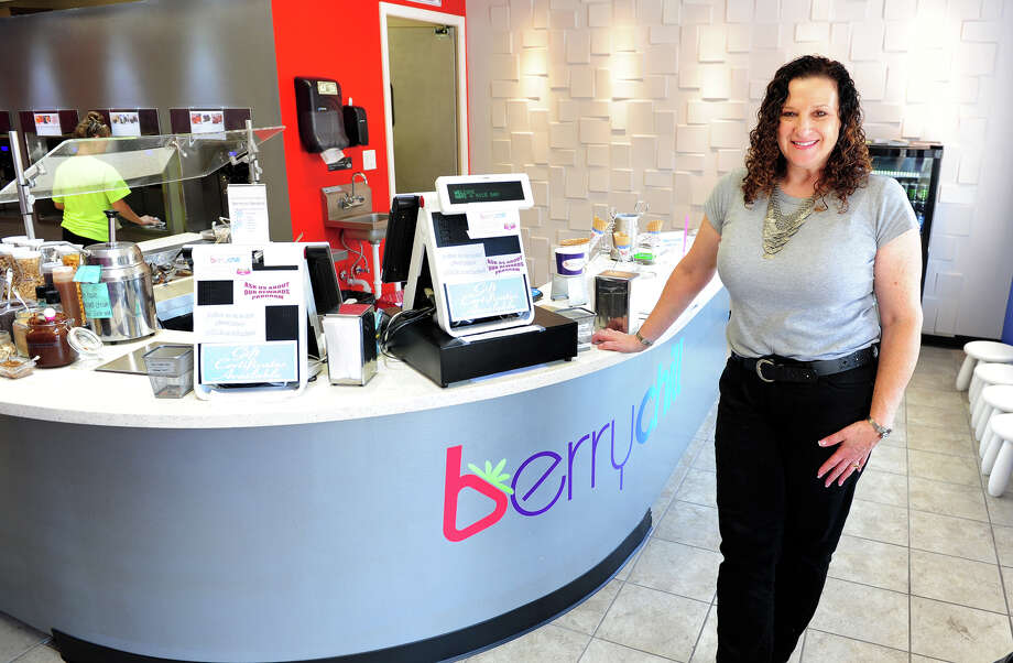 Beth Tepper poses inside her new frozen yogurt business, Berry Chill, in Shelton on Saturday, August 19, 2014. The family operated business offers a variety of frozen yogurts, such as non fat, low fat, sugar free, dairy freeand even gluten free. Photo: Christian Abraham / Connecticut Post